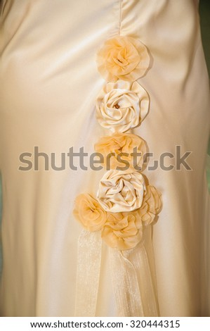 motif of four flowers in a wedding dress - stock photo