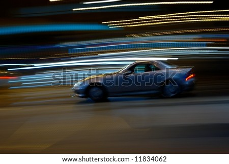 Motion abstract with blurred lights and sport car - stock photo