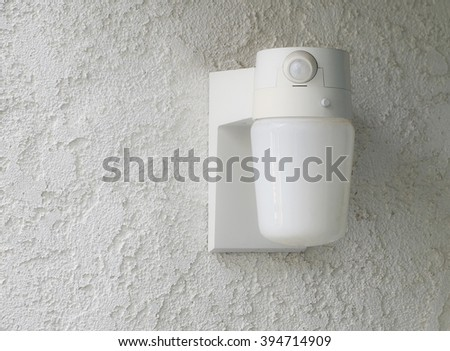 Motion activated porch light.  Home outdoor lighting.  - stock photo