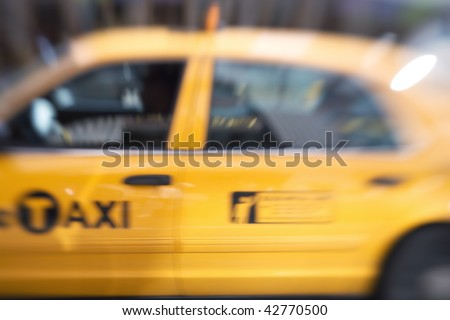 Motion and lens blurred taxi in New York - stock photo
