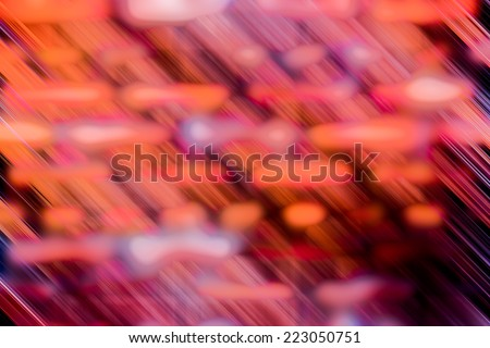 Motion blur abstract background of a brick wall in orange tone