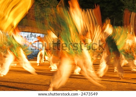 Motion blur abstract of a very Japanese festival dance during the night. - stock photo