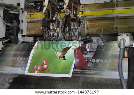 Motion blur, brochure and magazine stitching unit process. Close-up of the offset conveying process of a full-automatic stitching unit. - stock photo