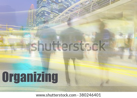 motion blur business people with skyscraper, organizing, business management concept