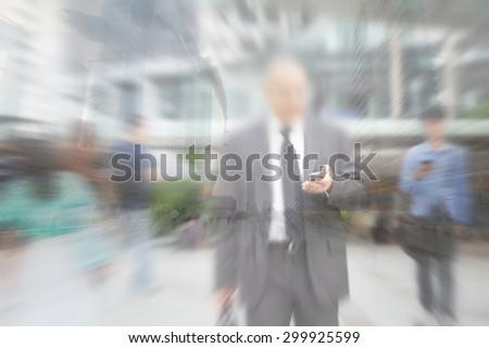 motion blur businessman hand on mobile phone - stock photo