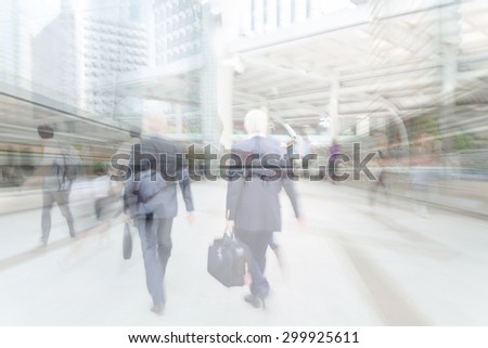 motion blur businessman walking to work - stock photo
