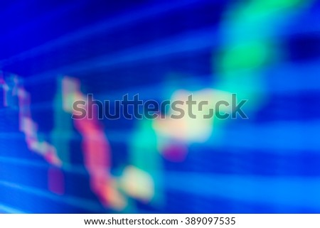 Motion blur effect. Macro close-up. Price chart bars. Stock market and other finance themes. Shallow DOF. Stock exchange graph. Share price candlestick chart. Finance background data graph. - stock photo