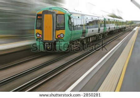 Motion blur from a fast speeding british train - stock photo