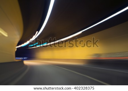 motion blur in highway tunnel at night - stock photo