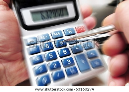 Motion blur of a calculator in the hands of a business man