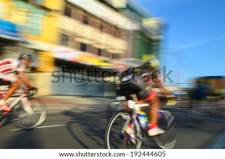 Motion blur of a group of cyclists in action during a cycling tour - stock photo