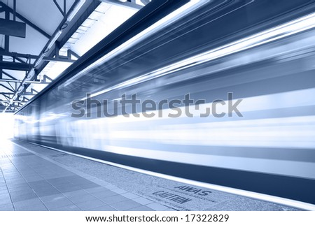 motion blur of moving train in blue tone