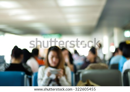 motion blur of passengers waiting at international airport - stock photo