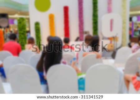 Motion blur of people wait for the show in publish activity