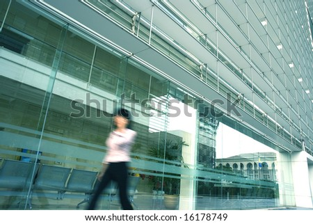 motion blur of people with various activities and buildings in blue tone - stock photo