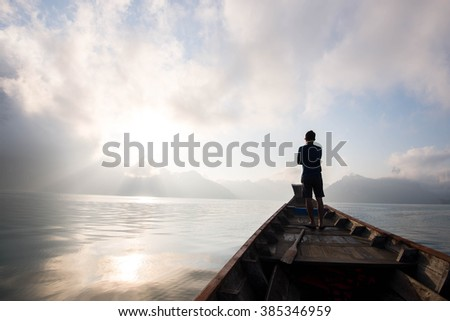 Motion blur of silhouette on boat