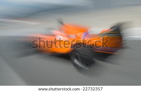Motion blur of sports car at motorsports championship race. - stock photo