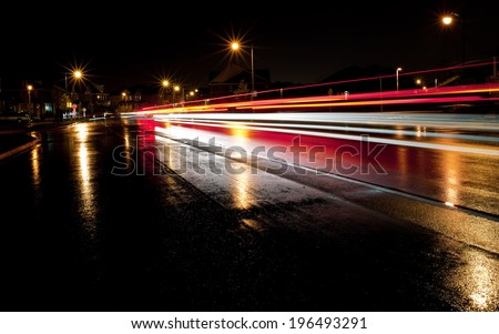 Motion blur of traffic on a busy city street. - stock photo