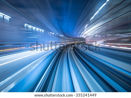 Motion blur of train moving inside tunnel in Tokyo, Japan - stock photo