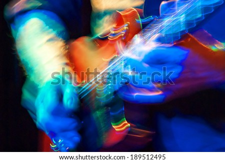 motion blur on an electric guitar - stock photo