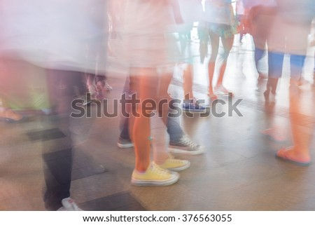 Motion blur people walking in fashion mall - stock photo