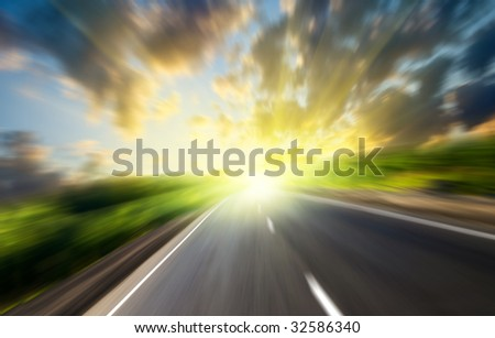 motion blur road and sun - stock photo