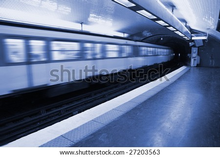 Motion Blur taken as Train speeds into a tunnel on the metro in central Paris - stock photo