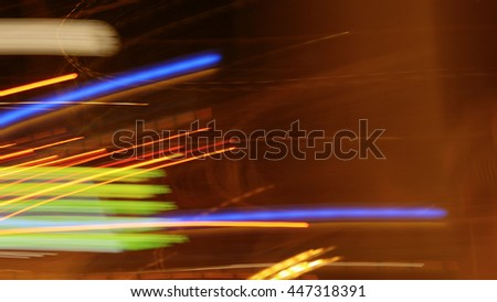 motion blur traffic lights stripes at night. colorful lines of streaks effect background. fast speed data stream concept
