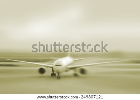 motion blurred airplane on runway                                - stock photo