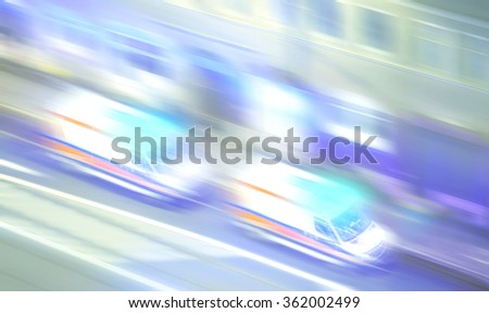 Motion blurred ambulances with flashing lights at night, emergency call concept picture. - stock photo