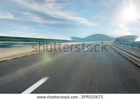 Motion blurred asphalt road empty street - stock photo