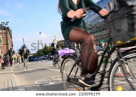 Motion blurred bikes in traffic - stock photo