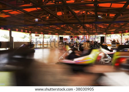 Motion Blurred Bumper cars at a outdoor Traveling Fairground.