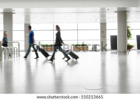 Motion blurred commuters At the Subway Station - stock photo