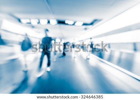 Motion blurred crowded people background with blue tone tuned