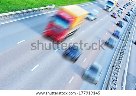 Motion blurred daytime traffic - stock photo