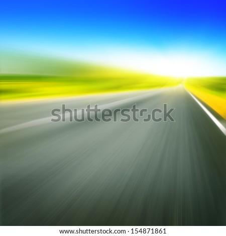 Motion blurred empty asphalt road. - stock photo