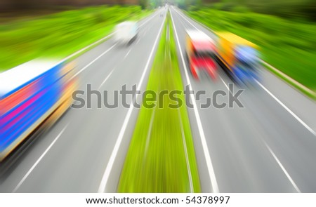 Motion blurred highway with traffic. - stock photo