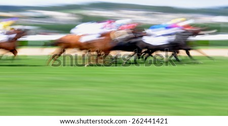 Motion blurred horse race background - stock photo