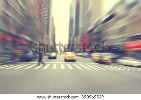 Motion blurred image of a city street scene. - stock photo