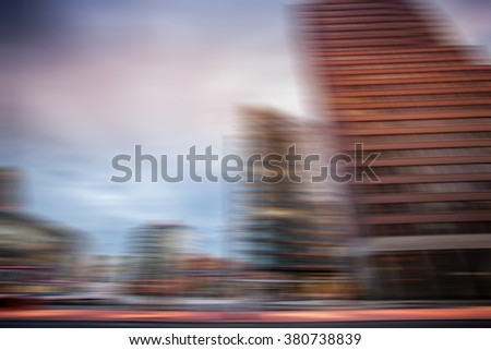 Motion blurred image of City, modern office buildings - stock photo