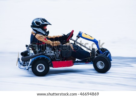 Motion blurred image of go kart race in winter - stock photo