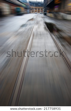 Motion blurred image of old tramway track of an industrial district - stock photo