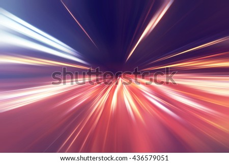 Motion blurred image of traffic lights on the road at night. - stock photo