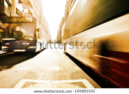 Motion blurred morning buses - stock photo