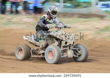 Motion blurred of quad bike - stock photo