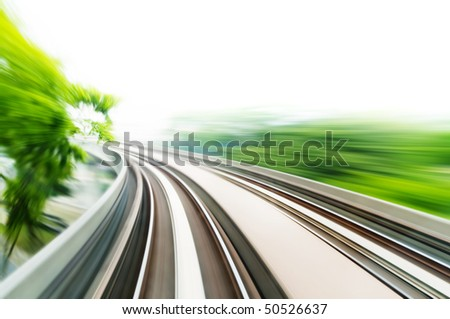 Motion blurred on speeding sky train. - stock photo