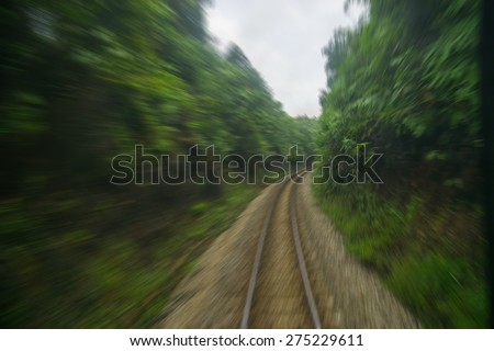 Motion blurred on speeding train with zooming effect