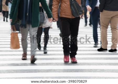 Motion blurred  people across Pedestrians at Shibuya Junction, Tokyo, Japan - stock photo