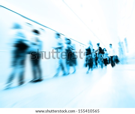 Motion blurred people walking at subway station.  - stock photo